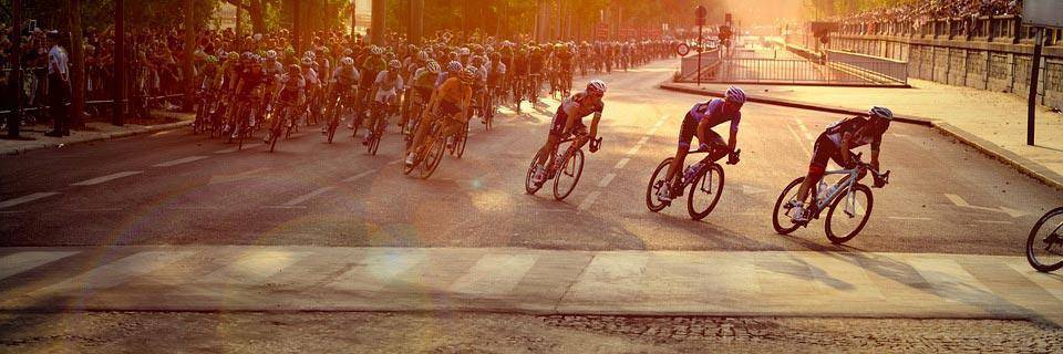 Tour de France cyclists in the sunset