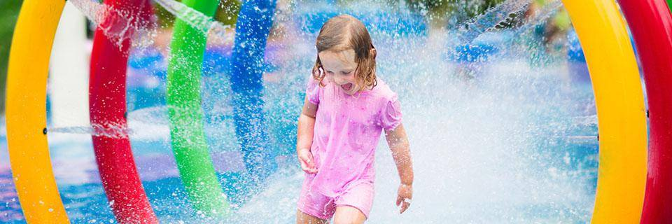 Little girl at a water park in Isle sur la Sorgue