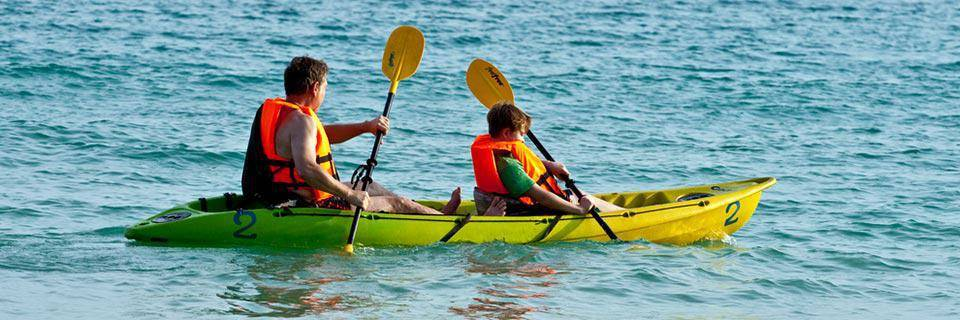 A father and son paddle in a kayak
