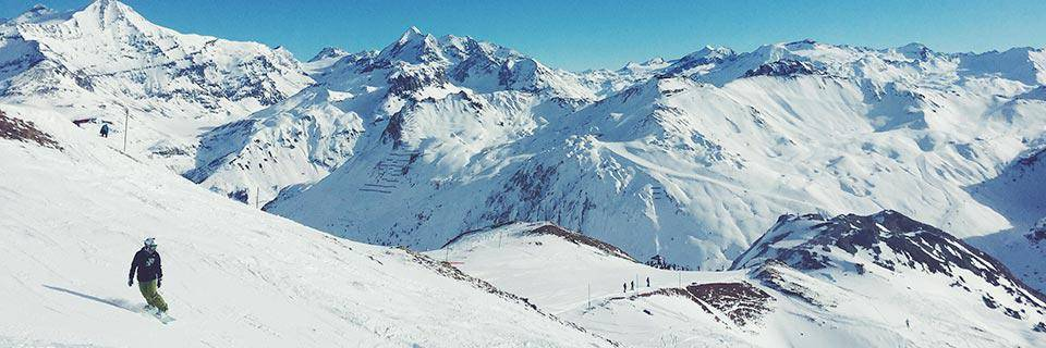 Snowboarder in a stunning French Alp vista