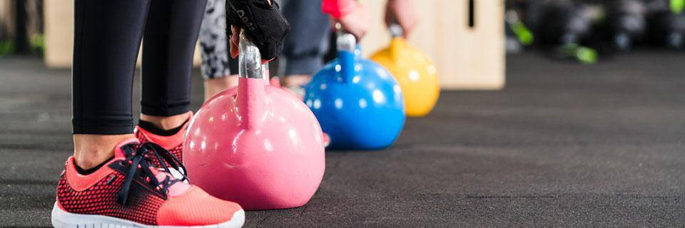 Line of people with dumbells
