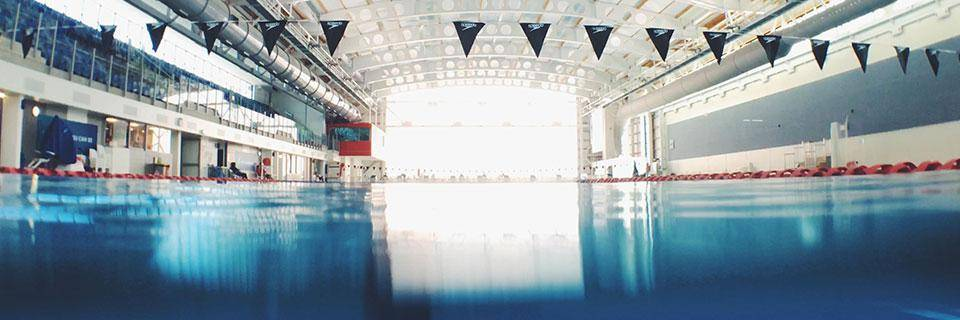 Large swimming pool is empty and calm